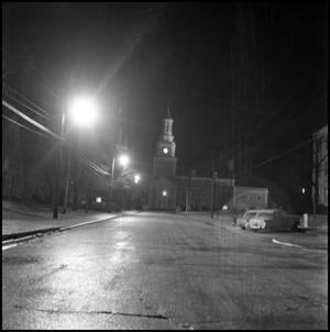 Primary view of object titled '[Administration Building from the north from Avenue B, at night]'.