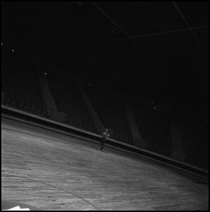 Primary view of object titled '[Woman walking in the coliseum]'.