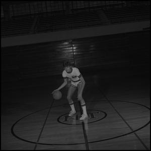 Primary view of object titled '[Randy Felhaber dribbling a basketball]'.