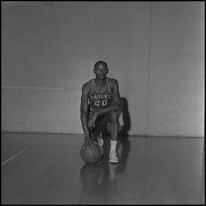 Primary view of object titled '[Ira Daniels kneeling with a basketball, 3]'.