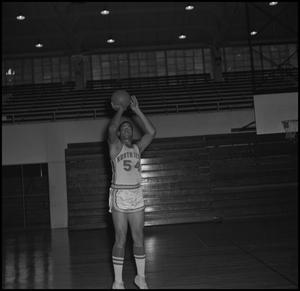 Primary view of object titled '[Willie Davis About To Throw Basketball]'.