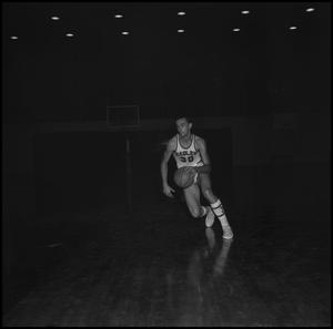 Primary view of object titled '[David Burns dribbling a basketball, 2]'.