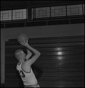 Primary view of object titled '[Varsity Basketball Player Wayne Hopkins]'.