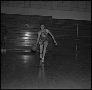 Primary view of object titled '[Butch Pruett dribbling a basketball, 2]'.