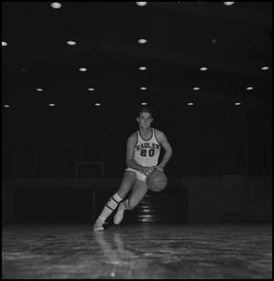 Primary view of object titled '[Ken Pemberton running along basketball court]'.