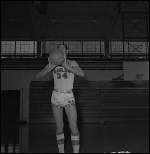 Primary view of object titled '[Carl Miller holding a basketball]'.