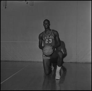 Primary view of object titled '[Albert Jones kneeling with a basketball, 2]'.
