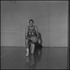Primary view of object titled '[Bob Burns kneeling with his basketball]'.