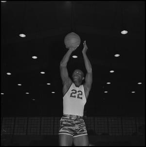 Primary view of object titled '[Oscar Miller shooting a basketball]'.