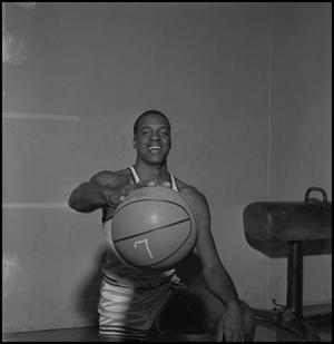 Primary view of object titled '[John Savage Posing with Basketball]'.
