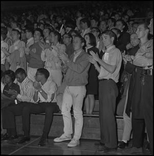 Primary view of object titled '[Spectators at a basketball game]'.