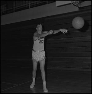 Primary view of object titled '[Mel Phillips passing a basketball]'.