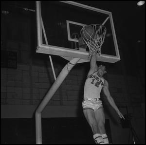 Primary view of object titled '[Carroll Carlisle Dunking Basketball, 2]'.