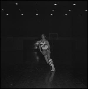 Primary view of object titled '[Carroll Carlisle running on court]'.