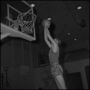 Primary view of object titled '[Skip Friz going to dunk the basketball]'.