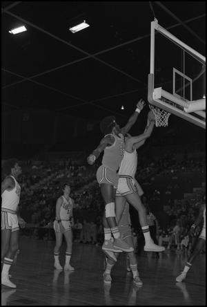 Primary view of object titled '[Eagles vs UTA in Basketball Game]'.