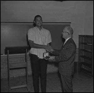 Primary view of object titled '[Willie Davis being presented a watch, 2]'.