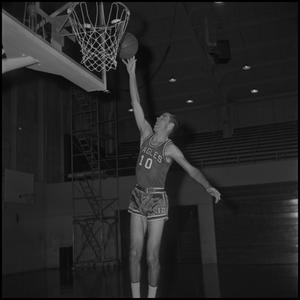 Primary view of object titled '[Ted Barnes going to dunk basketball, 2]'.
