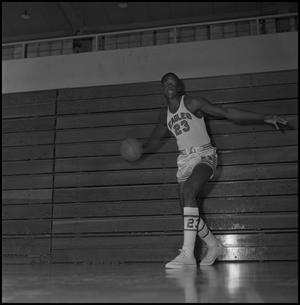 Primary view of object titled '[Albert Jones preparing to pass basketball]'.
