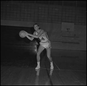 Primary view of object titled '[Frank Novak holding basketball, 2]'.