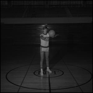 Primary view of object titled '[Kevin Angotti passing a basketball]'.