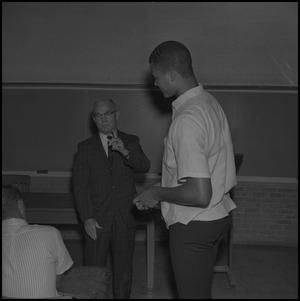Primary view of object titled '[Willie Davis and Older Man]'.