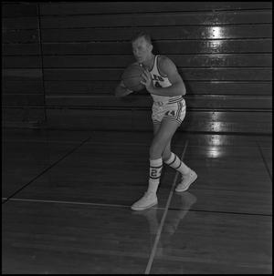 Primary view of object titled '[Bubba Bailey holding a basketball]'.