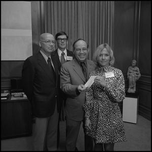 Primary view of object titled '[President Nolen receiving a check from representatives of Atlantic Richfield, October 9, 1975]'.