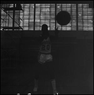 Primary view of object titled '[Joe Stephens Tossing Basketball]'.