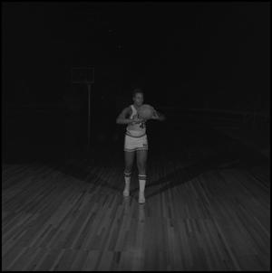 Primary view of object titled '[Palmo Simmons with a basketball]'.