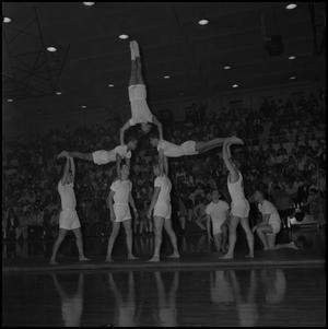 Primary view of object titled '[Men's Gymnastics at Half-Time Show]'.