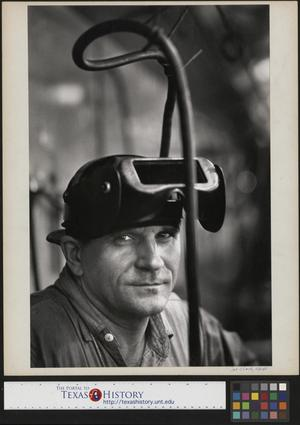 Primary view of object titled '[Unidentified man in welding mask]'.