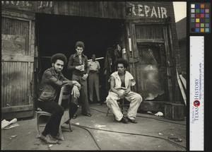 Primary view of object titled '[Men outside of a repair shop]'.