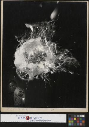 Primary view of object titled '[Slingshot John Milligan Shooting Through an Egg]'.