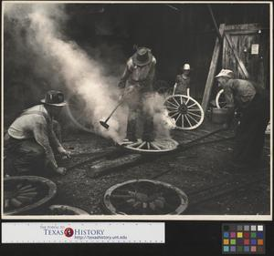 Primary view of object titled '[Men building wheels at Alex Cline's blacksmith shop]'.