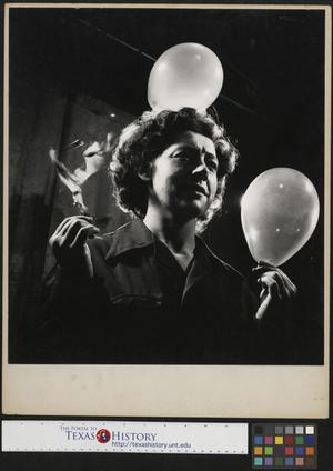 Primary view of object titled '[Slingshot John Milligan's wife Holding Balloons as one bursts]'.
