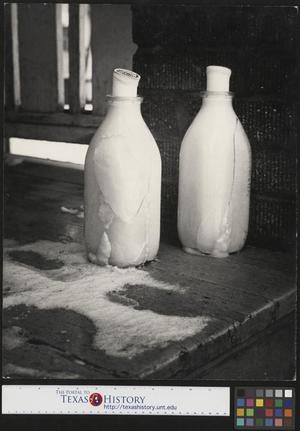 Primary view of object titled '[Two frozen milk bottles]'.
