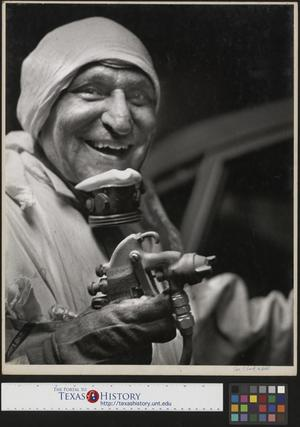 Primary view of object titled '[Man Working at Chrysler]'.