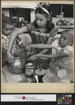 Primary view of object titled '[Three Girls Baking]'.