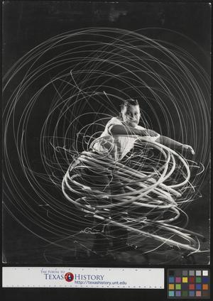 Primary view of object titled '[Long exposure of a boy with hoola hoops]'.
