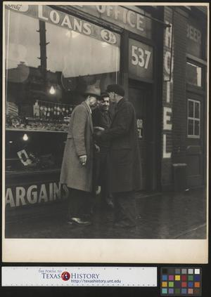 Primary view of object titled '[Three Men in Front of a Shop]'.