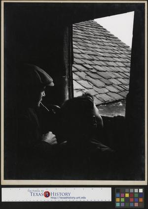 Primary view of object titled '[Man and boy look out a window]'.