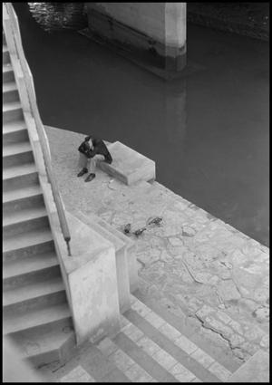 Primary view of object titled '[Man resting his head at Riverwalk]'.