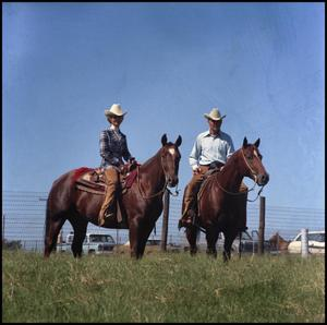 Primary view of object titled '[Buster and Sheila Welch on horseback]'.