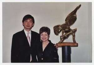 Primary view of object titled '[Dalton Lee and Dean LaBrecque next to eagle statue]'.