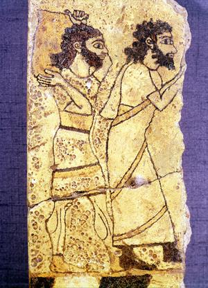 Fragment of a plaque depicting two men walking