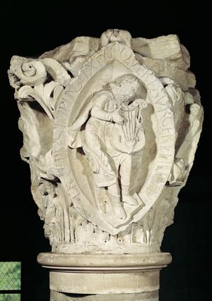 Capital depicting the Third Key of Plainsong with a lute player