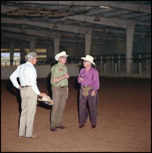 Primary view of object titled '[Three older men in the roping arena]'.