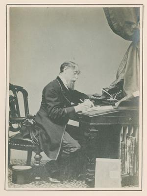 Primary view of [Photograph of Charles Dickens writing at desk]