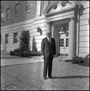 Primary view of object titled '[Dean A. Witt Blair standing outside of the Education Home Economics Building]'.